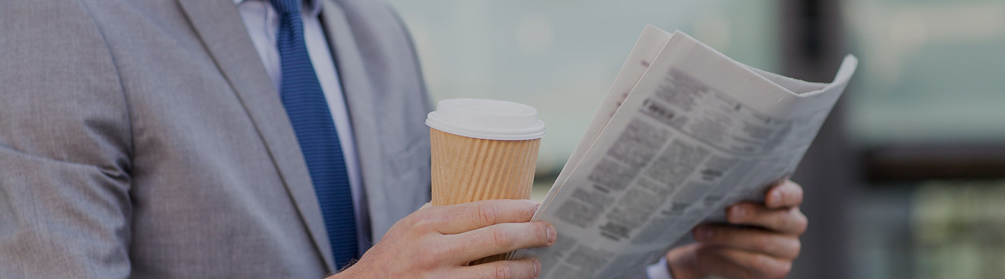 man with cofee and paper