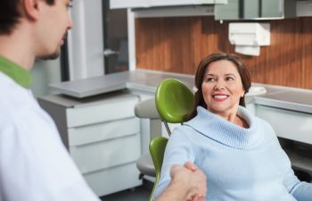 the patient and dentist shake hands